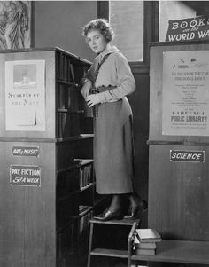 The Lost Romance (1921).  The first movie librarian recorded on a ladder.