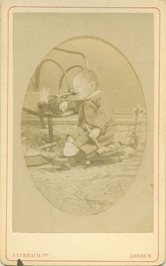 """This boy named Herre died in 1873 at the age of two years and a half. The photo was found in his father's diary, which mentions the following: """"We had one portrait made in his bed after he died by Ephraim. Later he put the head on a portrait of his child, wearing Herre's clothes, which became quite good"""". A very unusual example of early photoshopping avant la lettre!"""