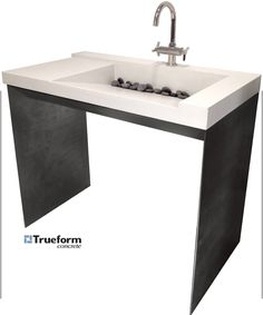 ADA compliant sink. Concrete on a steel base. Could be for indoor/outdoor bathroom.