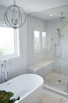 Freestanding Tub & Large custom walk-in shower with custom shower bench and spa rain fixtures. Large corner shower. White & Gray bathroom with herringbone tile floor and grey vanity. Designer bathroom renovation tips. #bathroomrenovation #bathroomgoals #freestandingtub #whitebathroom #cleanminimalbathroom White Tile Shower, Tile Walk In Shower, Black And White Tiles Bathroom, Modern Bathroom Tile, Bathroom Interior Design, Bench In Bathroom, Master Bathroom, Large Shower, Design Room