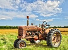 Red Old Rusty Tractor In A Field Royalty Free Stock Photo, Pictures, Images And Stock Photography. Image 9462998.