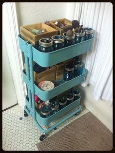 Ikea RÅSKOG cart with blue Ball mason jars for hair & makeup storage