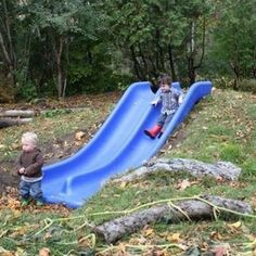 a slide built into the hillside is totally brilliant.. I love this, I'm always worried that those cheap slides tilt to the side, this can prevent that.
