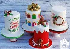 """Holiday themed display cakes for Christmas! The """"Merry Chrismtas"""" is freehand calligraphy with hand painted floral design. The """"presents"""" are fondant gift boxes topped with an edible glitter bow! The 'JOY"""" is fondant letters. Mini Christmas Cakes, Christmas Themed Cake, Christmas Cake Designs, Christmas Cake Decorations, Christmas Sweets, Christmas Minis, Holiday Cakes, Christmas Goodies, Christmas Baking"""