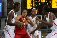 Maimouna Diarra #11 of Senegal and Miranda Ayim #9 of Canada go after a rebound in the Women's Basketball Preliminary Round Group B match between Canada and Senegal on Day 5 of the Rio 2016 Olympic Games at Youth Arena on August 10, 2016 in Rio de Janeiro, Brazil. (Source: Rob Carr/Getty Images South America)