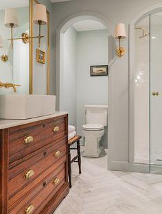 Marble herringbone and vintage vanity in bathroom