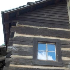 This is a log cabin from the 1700's at Red Bird Mission in Kentucky.  I love the effect of the sky in the window.