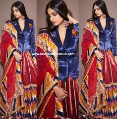 Rhea Kapoor attended the pre wedding bash of Isha Ambani and Anand Piramal and she was seen in Maroon leheng paired with royal blue pocket shirt paired with matching duppata by in a Abu Jani Sandeep Khosla. Statement jumkhas , straight hair and bold makeup rounded her look.