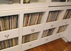 Designer Kenneth Brown offers this smart idea for integrating vinyl record collections into a home. Instead of bulky record shelves he designed pull-out, partially exposed drawers to house a family's records. Record Shelf, Vinyl Record Storage, Lps, Cd Storage, Storage Drawers, Magazine Storage, Vinyl Record Collection, Muebles Living, Storage Solutions