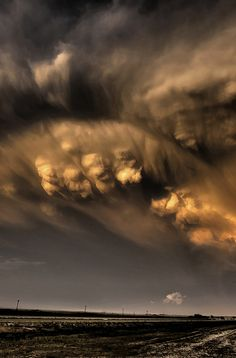 Bubbling pockets of mammatus clouds, formed by cold air sinking through the anvil of departing thunderstorms, create for a deep and colorful sky at sunset. Weather Cloud, Wild Weather, Tornados, Thunderstorms, Beautiful Sky, Beautiful World, Mammatus Clouds, Sky And Clouds, Storm Clouds