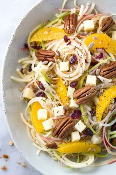 Spiralized Apple Salad with Citrus Dressing - Healthy and refreshing recipe made in only 15 minutes! Topped with oranges, pecans, cheddar cheese, cranberries, sunflower and chia seeds. via foodiegavin Best Apple Recipes, Apple Salad Recipes, Healthy Salad Recipes, Fall Recipes, Vegetarian Recipes, Delicious Recipes, Spiralizer Recipes, Walnut Salad, How To Make Salad