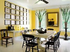 Saturated yellow walls warm up graphic black and white accents in a geometric dining room. | Photo: Eric Roth | thisoldhouse.com