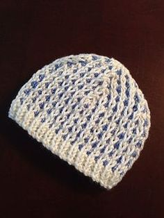 I saw this stitch on a baby cardigan pattern and thought it would make a cute hat. It does! The pattern is written for a newborn, but increasing the cast on in increments of 12 will work to make larger sizes.