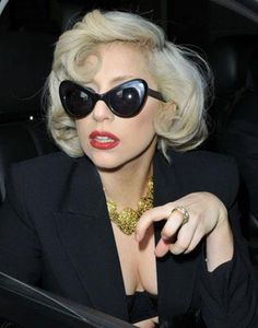Lady Gaga channels Marilyn Monroe in cat eye glasses. The Fame Monster, Lady Gaga Photos, Latest Celebrity News, Poses, Norma Jeane, Hairstyles For School, Vintage Hairstyles, Workout Pants, Cat Eye Sunglasses