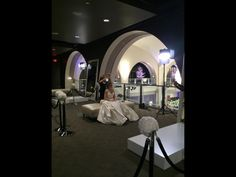 Stylist Gina doing a bridal trial with a bride to be at the Pnina Tornai trunk show at the Wedding Room show for Kleinfeld's Hudson Bay Toronto 2014