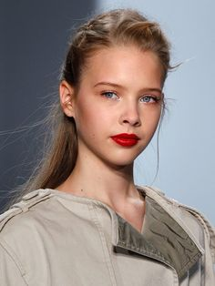 Metallic silver on the inner corners paired with a bold red creme on the lip