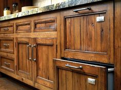 Really liked these wood kitchen cabinets. Spanish Mission style LIKE COUNTER TOP HINT IF GREEN. ? ON FLOOR COLOR