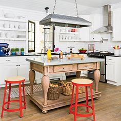 Architect John Hurst increased square footage in this kitchen and on the porch, and added a large double window to connect the two spaces. | Coastalliving.com