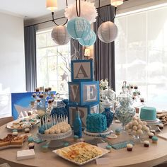 """Baby Shower for a boy """"Twinkle Twinkle Little Star"""" Dessert Table set up.  3 Custom cakes with Rosette & Confetti designs, Custom printed Baby Name Sugar Cookies, Cake Pops, Edible Baby Rattles, Cupcakes, and more."""