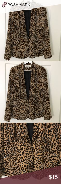 Leopard print blazer Loose fitting leopard print blazer. Silk material with zip pockets in the front and small clasp that buttons in the front. Daielrainn Jackets & Coats Blazers