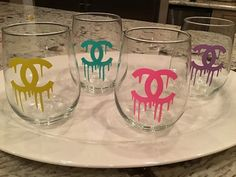 Super fun summer wine glass set of 4 with Chanel inspired logo in hot colors! These are available in plastic or glass! Custom color requests available. Etched Wine Glasses, Wine Glass Set, Personalized Tumblers, Custom Tumblers, Custom Bottles, Glitter Wine, Glitter Bottles, Nail Salon Design, Wine Glass Crafts