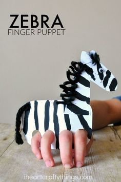 This finger puppet zebra craft is fun for kids to make and kids will love playing with their zebra craft by making it gallop around the house.