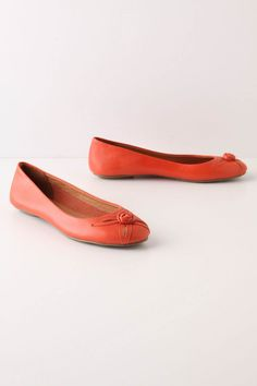 Anthropologie Sweetbriar Skimmers in Coral.  Also available in turquoise.  Love both colors.