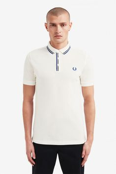 Fred Perry Tipped Placket Polo Shirt- White (Fred Perry). Our classic polo shirt- made in cotton piqué in our regular fit. Trimmed with twin tipping at the placket with concealed buttons. Punk Store, Polo Shirt White, Fred Perry, Arrow Keys, Close Image, Punk Rock, Good Music, Guys, Mens Tops