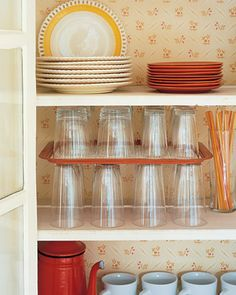 Serving Tray Divider Add more storage space and keep cups together by using a serving tray as a divider.  Find out more at Martha Stewart.