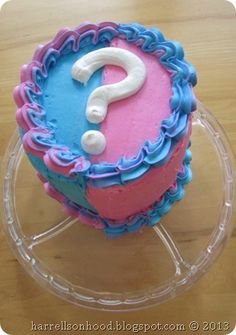 gender reveal party idea, pink and blue cake with colored m's inside