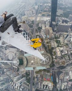 Climbing a spiral on the Shun Hing Square in Shenzhen: Vitaliy Raskalov and Vadim Makhorov scale Hong Kong's 2,000ft skyscrapers.