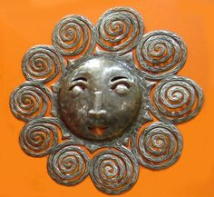 Spiral Sun Haitian Wall Art  I wish there was a crescent moon to go with this! They'd look so great together.