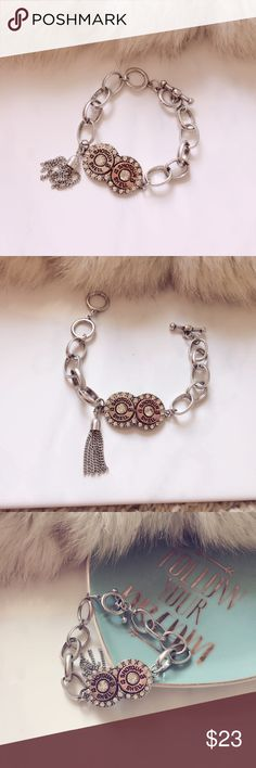 Shotgun Shell Rhinestone Bracelet Beautiful shotgun shell bracelet with rhinestones is beautiful to add to that summer dress, cowboy boots or jeans! Mixed alloy metal features a silver and copper shell with a Tiffany style clasp! Jewelry Bracelets