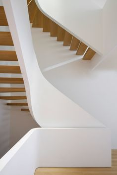 Curving white staircase with oak treads added to New York townhouse
