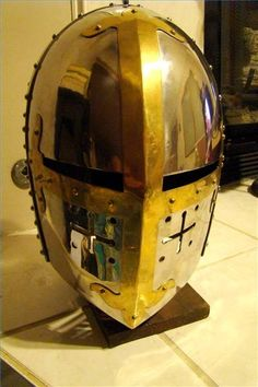Looks like a Sugarloaf Crusader Helmet or Great Helm was created early in the century. Most popular helmet for next 300 years Warrior Helmet, Helmet Armor, Arm Armor, Medieval Knight, Medieval Armor, Medieval Fantasy, Crusader Helmet, Medieval Helmets, Ancient Armor