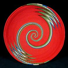 Zulu recycled telephone wire basket. Visit this site: http://www.indigoarts.com/store1_telephone_7.html to see a whole gallery of beautiful baskets. It's like an on-line art show!