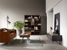 Scandi loft design by BoConcept Lether sofa, black bookcase, space Boconcept Trójmiasto BoConcept Gdynia Danish Furniture, Home Furniture, Furniture Design, Modern Furniture, Scandinavian Interior Design, Scandinavian Furniture, Boconcept Sofa, Masculine Living Rooms, Wooden Bookcase