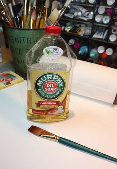 How to clean dried acrylic paint from a paintbrush: just soak the brush in Murphy's Oil Soap. (Art du Jour by Martha Lever: Here's a good tip...)