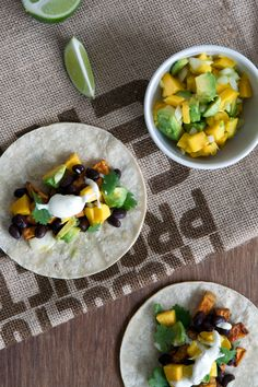 sweet potato tacos with black beans and mango // 1000threadsblog.com  Sub cashew sour cream to make vegan/dairy free