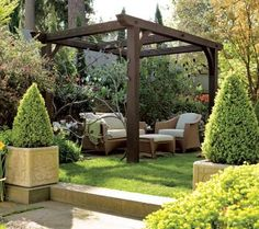 Enhanced by wrought iron panels, a simple wooden pergola frames an outdoor seating area. - Traditional Home ® / Photo: John Granen / Design: David Pfeiffer