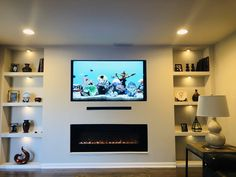 White lights under my built in wall unit with electric fireplace Built In Shelves Living Room, Built In Wall Units, Feature Wall Living Room, Living Room Wall Units, Living Room Tv Unit Designs, Open Plan Kitchen Living Room, Wall Units With Fireplace, Living Room Decor Fireplace, Living Room Decor Cozy