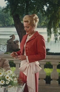 Elsa Schrader (Eleanor Parker) 1940s The Sound of Music......I need to own this suit. Something about the audacity of an impractical side bow and layers of pearls.