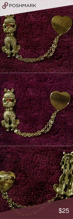 Brass Poodle Pin 1950's Sweater Pin Darling 1950's poodle and heart sweater pin. Poodle is brass and has Ruby red crystal eyes and Crystal diamonds on his collar. Both poodle and heart have pins on the back.  Use to wear as a closure for a sweater but also just makes a cute pin Antique Jewelry Brooches