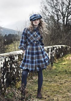 Catriona is wearing a Tartan Spirit Puffball Coat in Holyrood Tartan w/ matching cap. All the girls here dress in traditional garb......