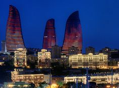 """The towers in Baku, Azerbaijan, are completely covered with LED screens that mimic fiery flames and giant torches. The design was inspired by Azerbaijan's history as a land of fire, due to its rich deposits of natural gas. Concrete is the predominant material, while the tops of the three buildings contain a lighter steel structure to create the impression of a flickering flame."" #lightingdesign"