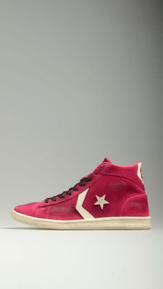 Fuxia scruff leather lace-ups high top sneakers featuring vintage appearance, supplied laces, rubber sole.