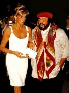 September 12, 1995: Princess Diana is greeted by Pavarotti on arrival for his concert to raise money for Bosnian children in Modena, Italy.