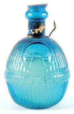 Harden's Star, Ribbed Bottle, Blue, 7 inchA Harden's Star glass fire grenade in sapphire blue with contents