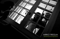 Bride and groom seem to be spying their guests through the window!