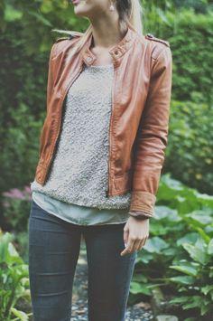 brown leather jacket, textured sweater, black skinnies